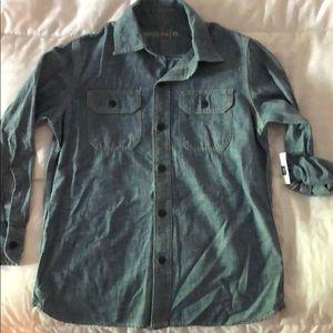 Boys size medium denim button down shirt.  NWT